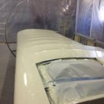 Right wing in paint booth after painting.